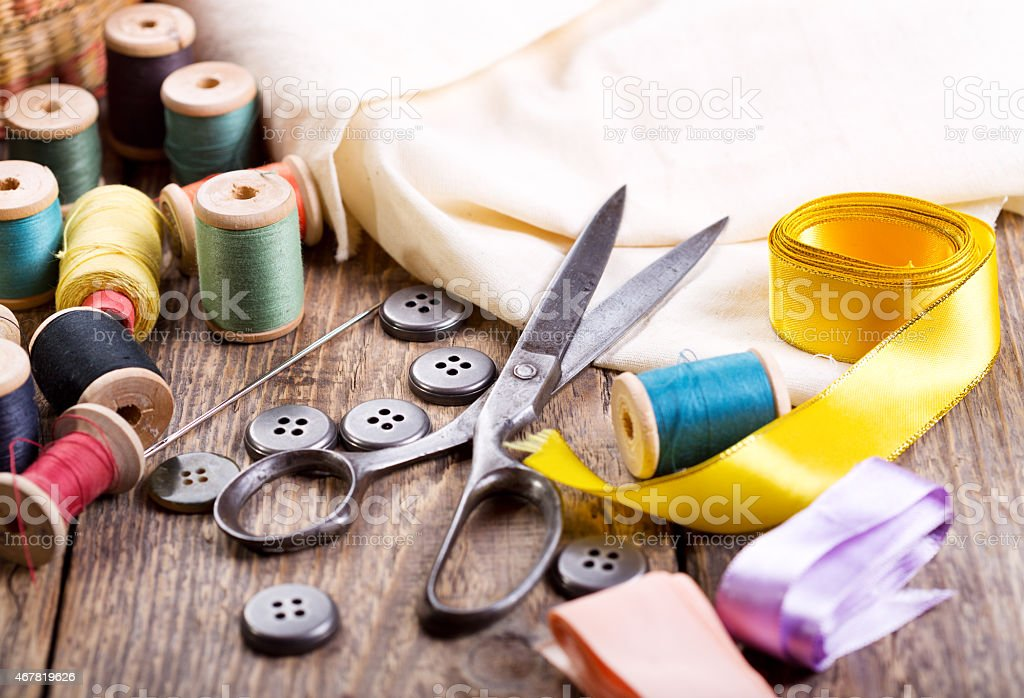 Old scissors, buttons, threads stock photo