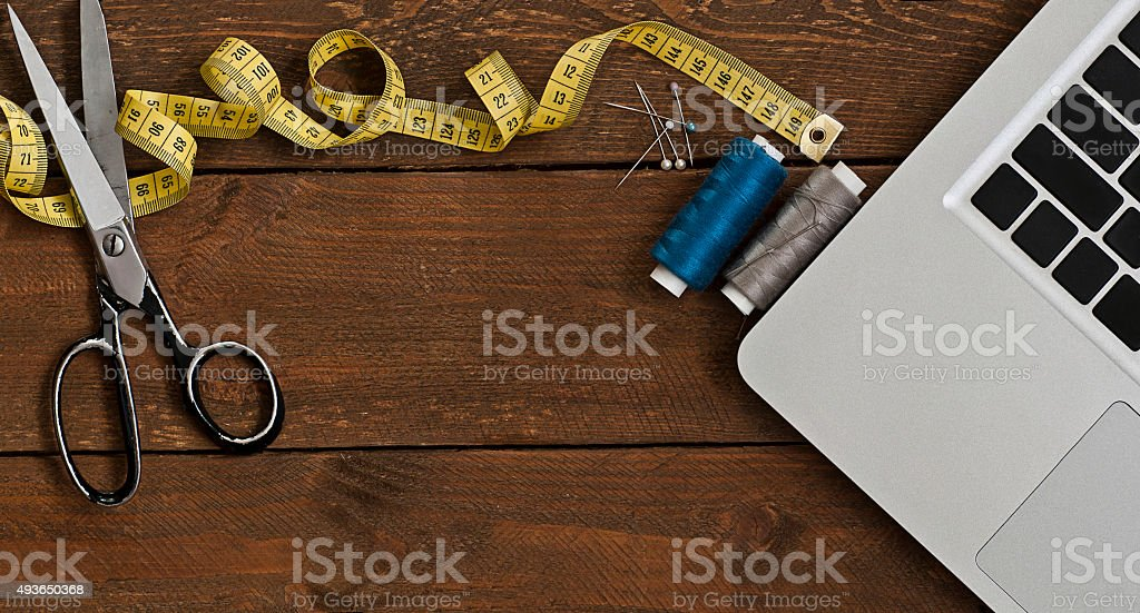Old Scissors, sewing set and computer on wood stock photo