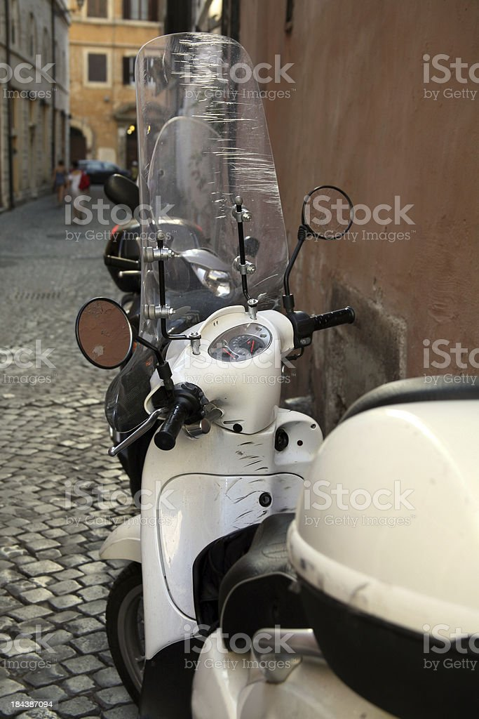 Old scooter in italian street. royalty-free stock photo