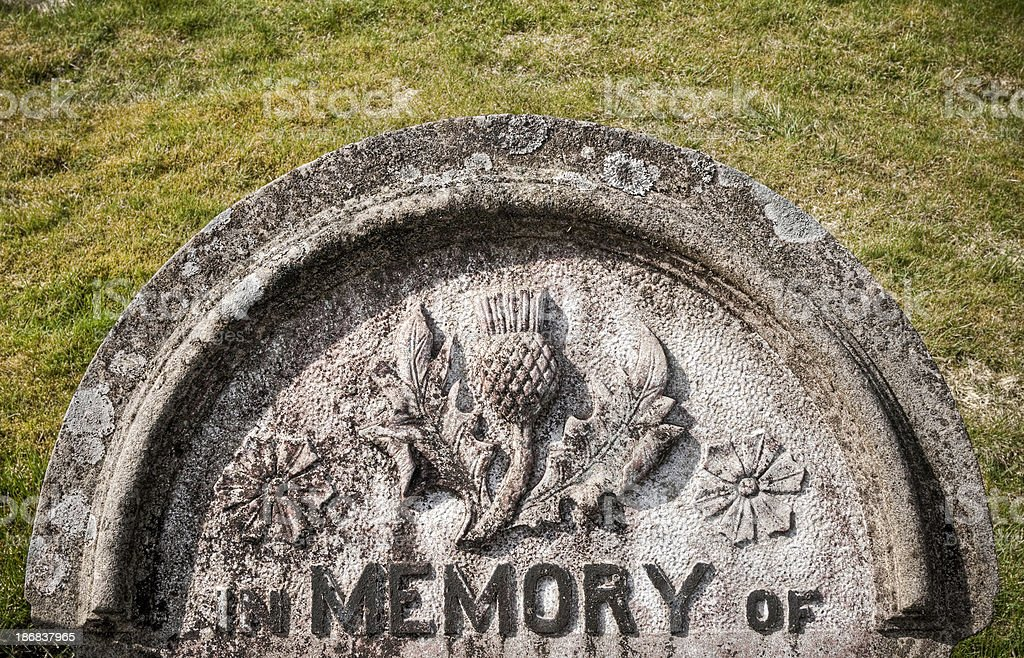 Old Scottish memorial gravestone with interesting thistle carving stock photo