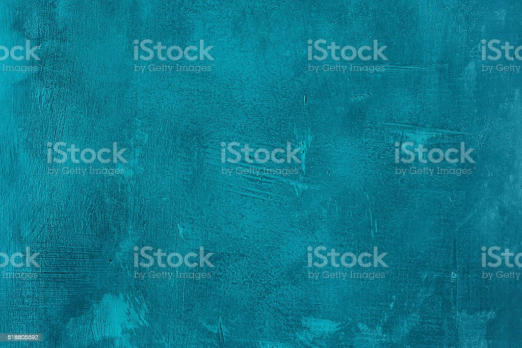Old scratched and chapped painted blue an turquoise wall stock photo