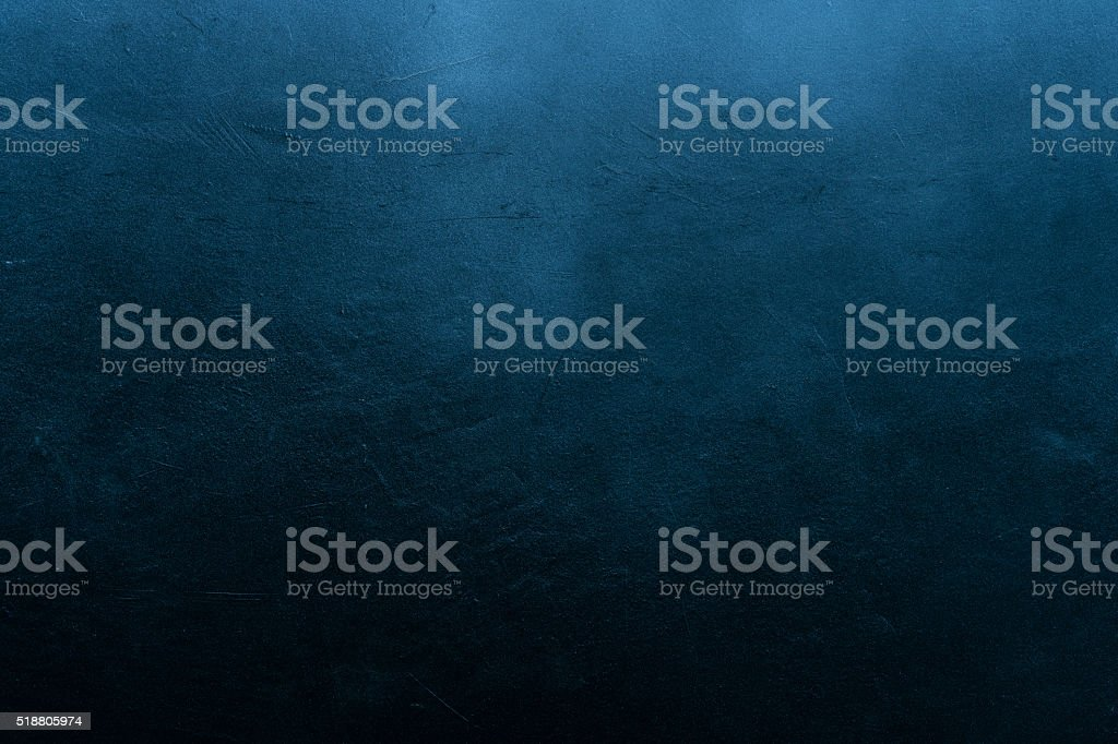 Old scratched and chapped painted dark blue wall stock photo