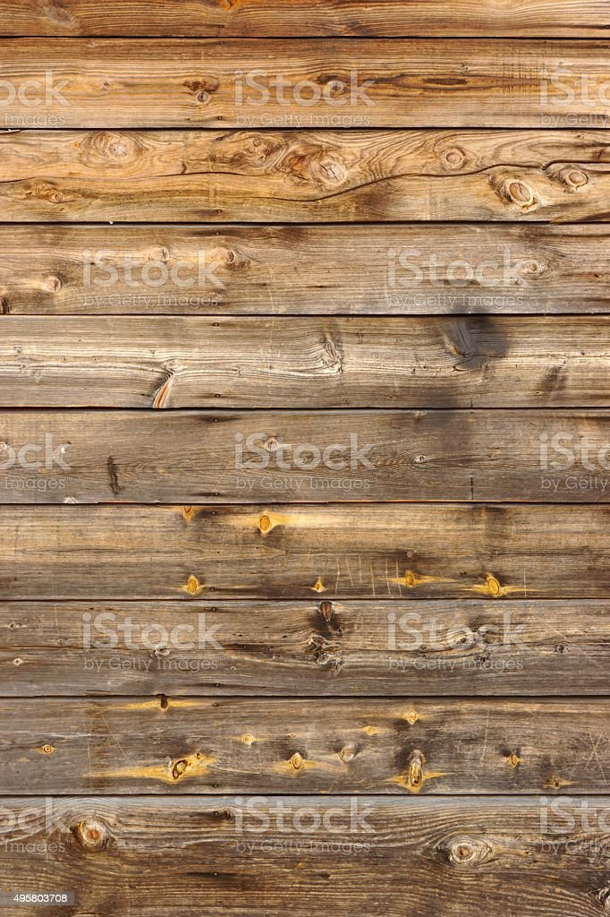 Old Scratched Brown Wood Panel Vertical Texture stock photo