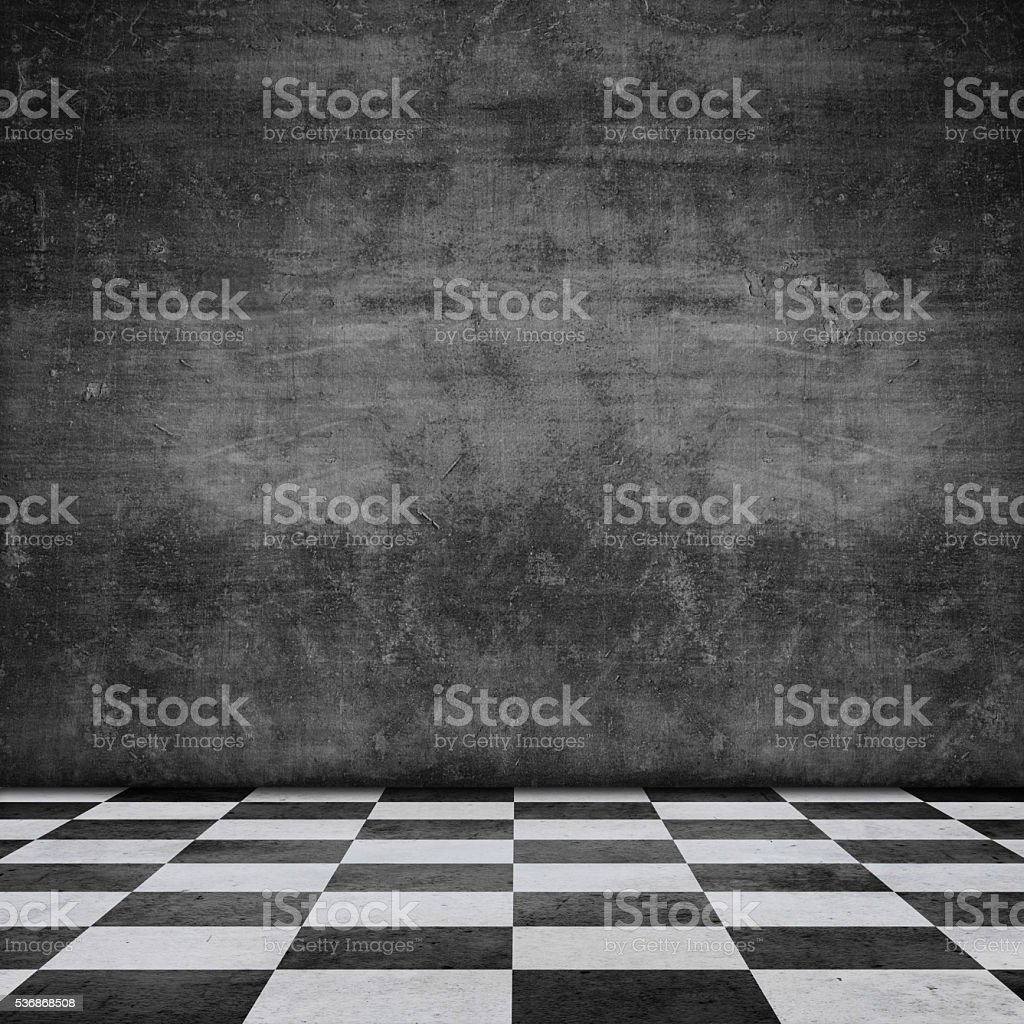 old scratched wall chequered pattern floor stock photo