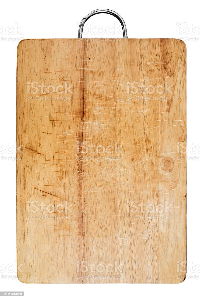 Old scratched wooden cutting board, isolated on white background stock photo