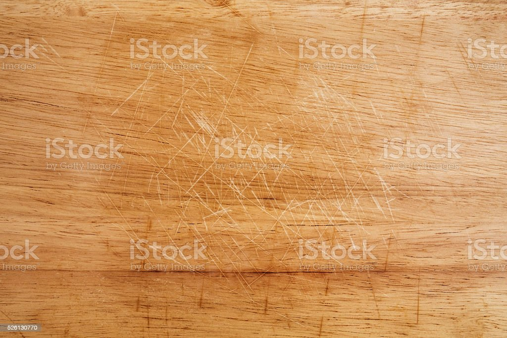 Old scratched wooden cutting board texture stock photo
