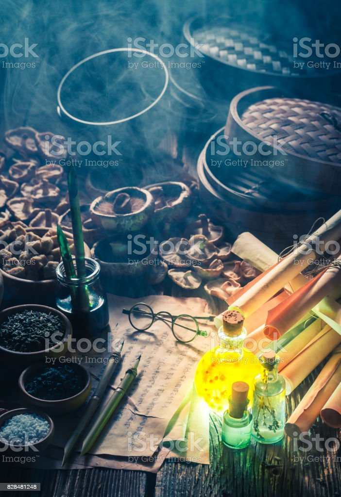 Old scrolls and recipe in magical research lab stock photo
