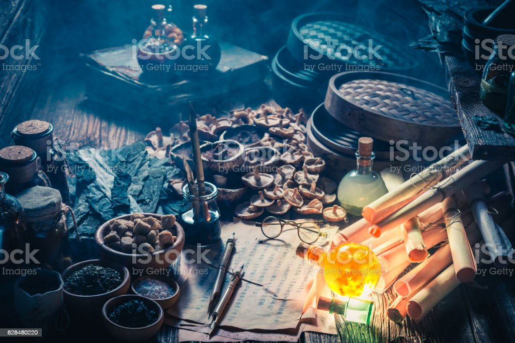 Old scrolls and recipe in vintage alchemist laboratory stock photo