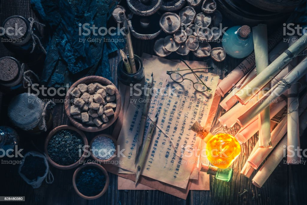 Old scrolls and recipe in vintage kitchen laboratory stock photo