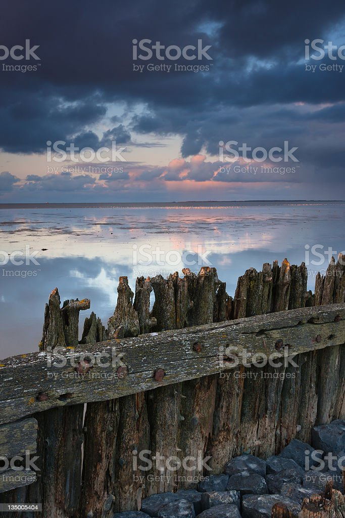 Old sea barrier stock photo