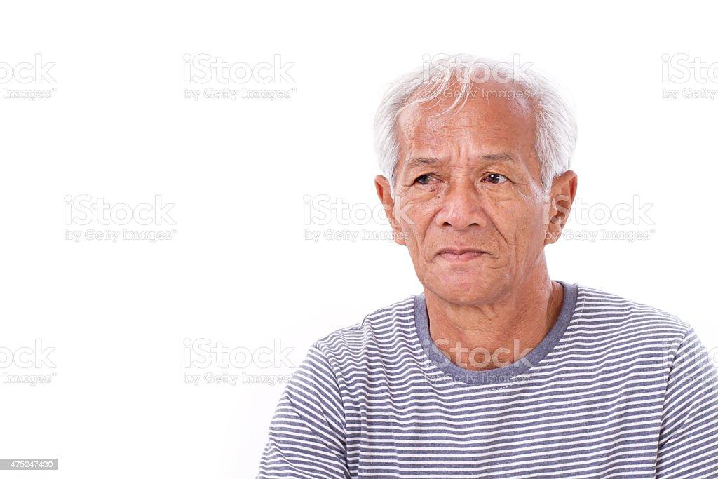 old senior man suffering from eye disease, surfer's eye, pterygi stock photo