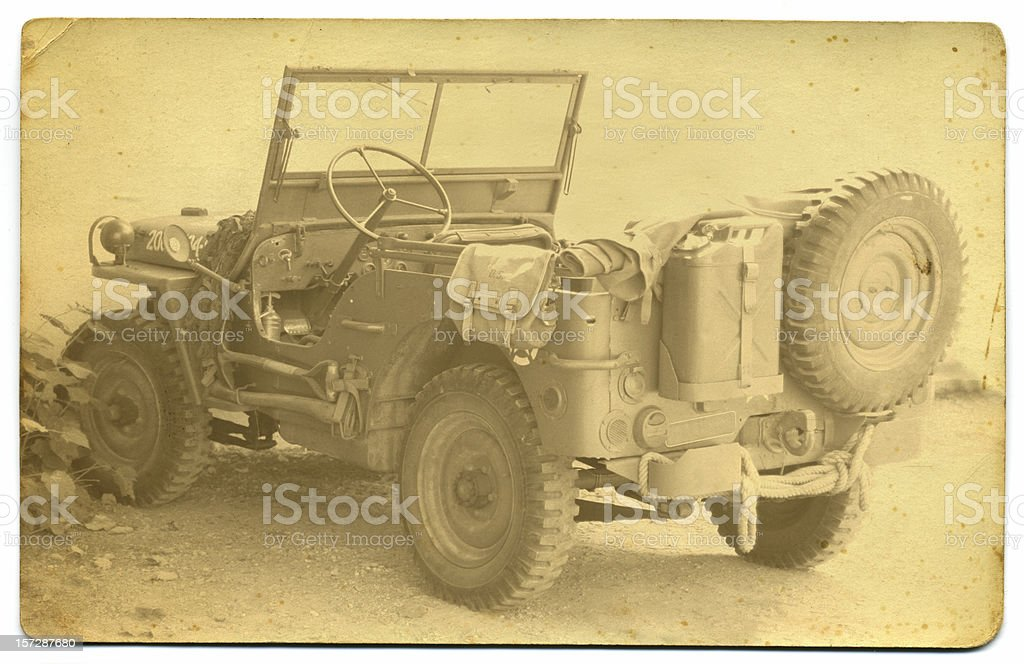 Old sepia photograph of army jeep stock photo