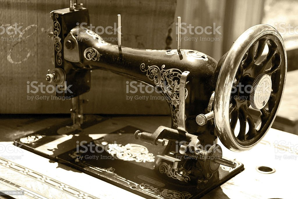 old sewing machine in sepia stock photo