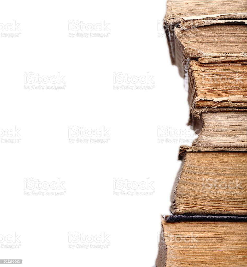 Old shabby books in the stack stock photo