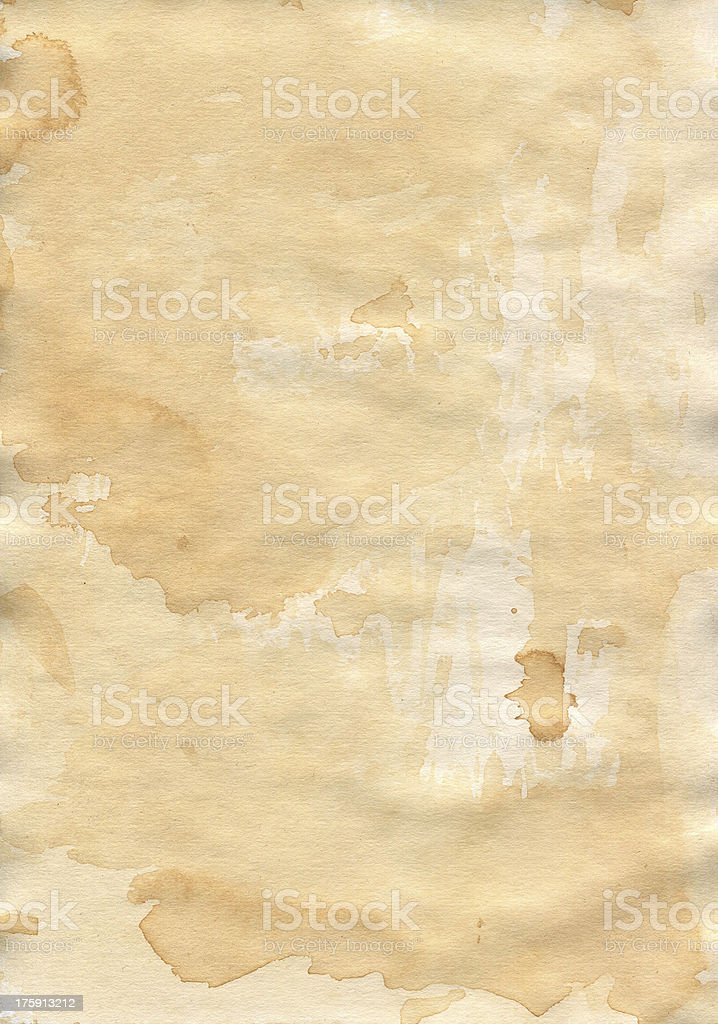 Old shabby paper. Carelessly spilled. Impregnated with tea. royalty-free stock photo