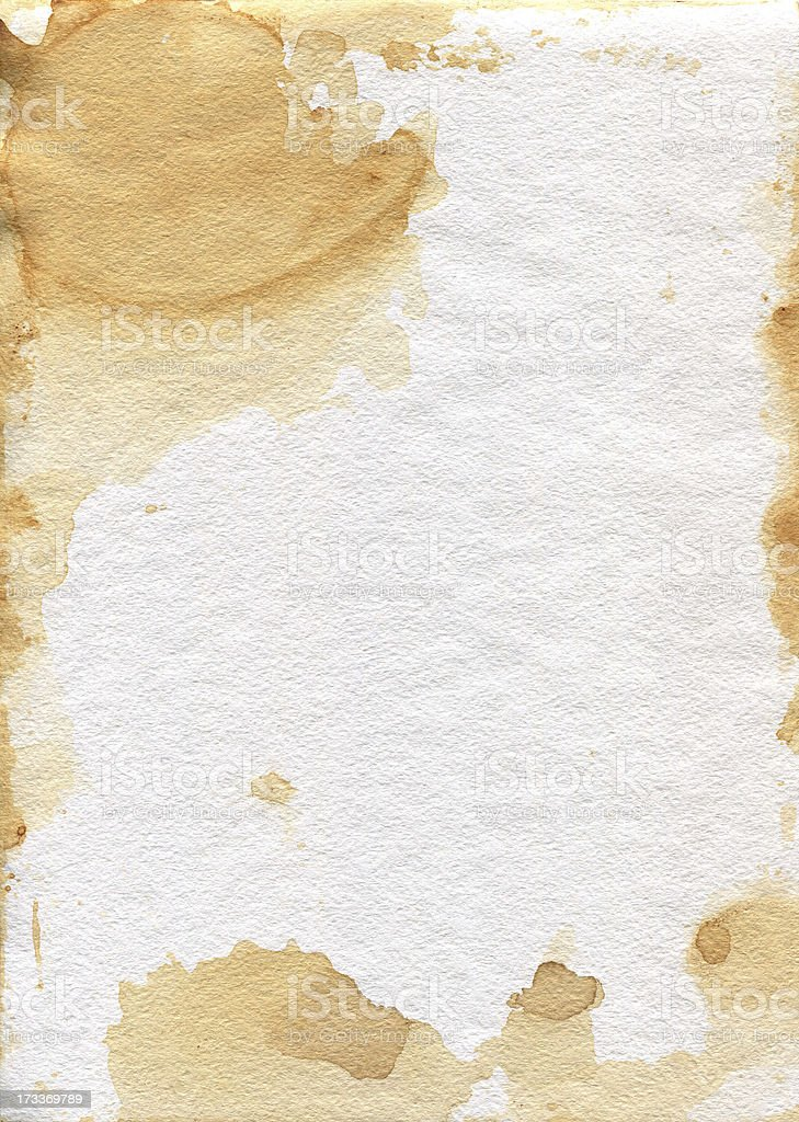 Old shabby paper. Granular texture of the paper.Tea stains. royalty-free stock photo