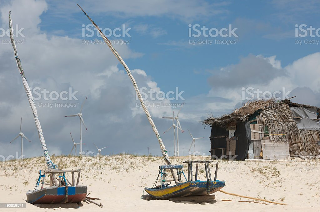 Old shack and jangada sailing boats at Brazilian beach stock photo