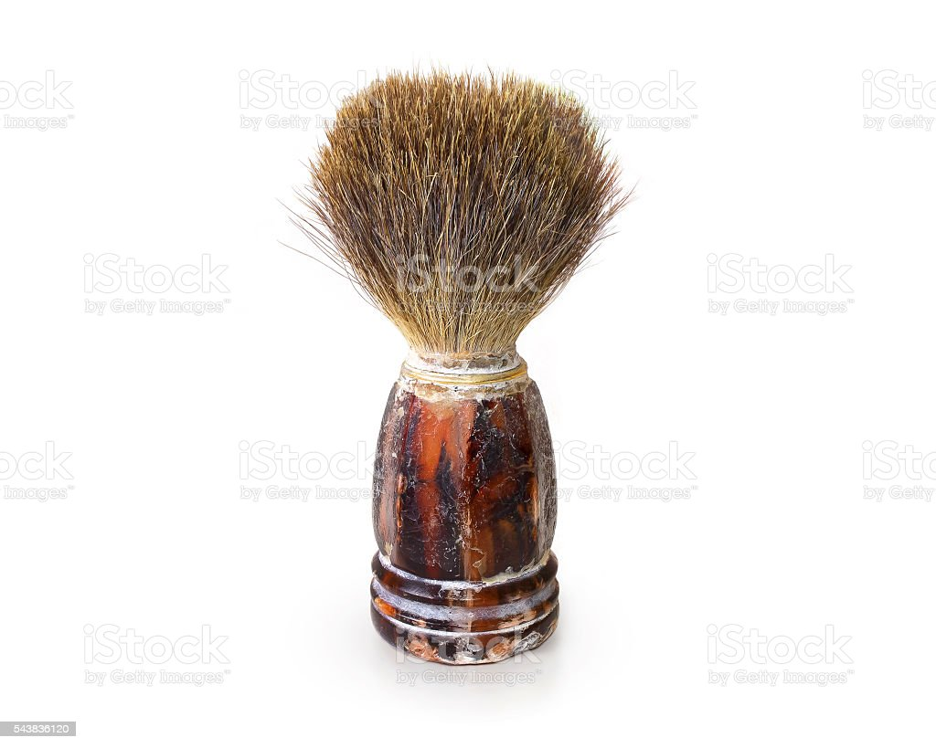 Old shaving brush isolated. Retro mens swab stand on white stock photo