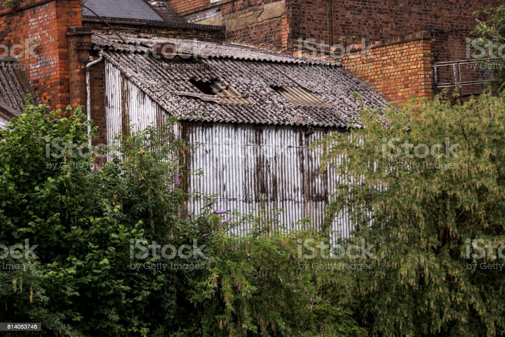 Old shed by the tenement house stock photo