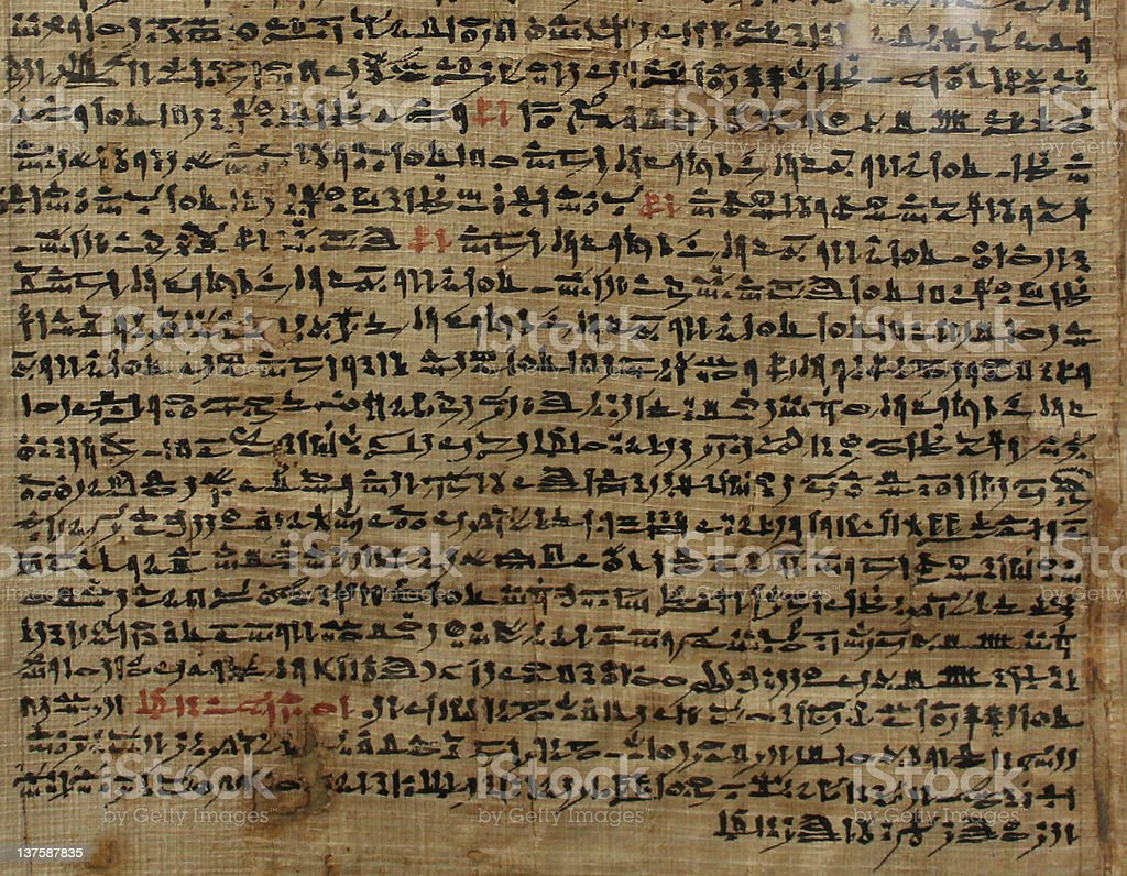 Old sheet of Egyptian papyrus with script stock photo