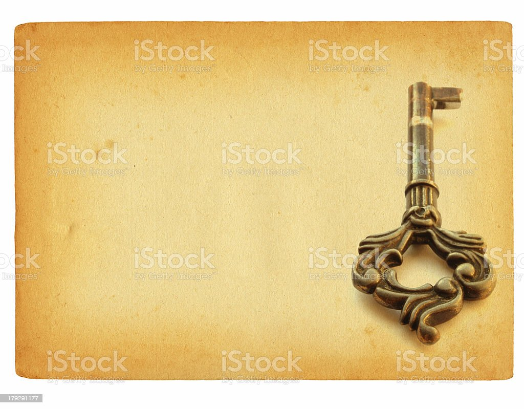 old sheet of paper with key motif stock photo