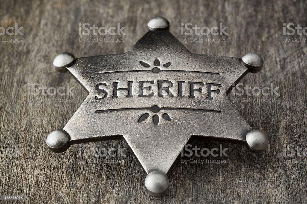 Old Sheriff Badge on Weathered Wood stock photo