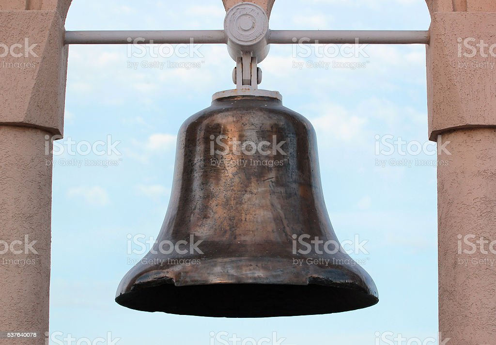 Old ship bell found at sea bottom as a monument stock photo