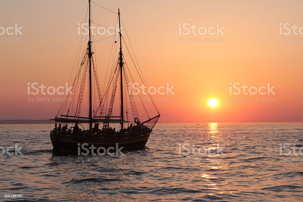 Old ship out to sea during sunset in Croatia stock photo
