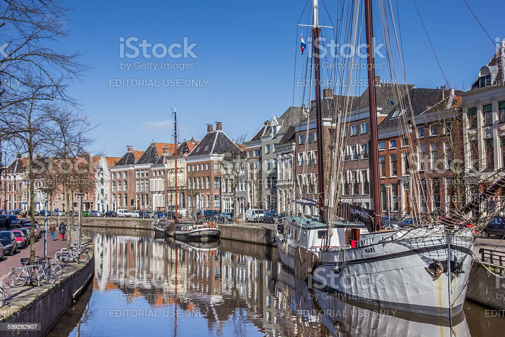 Old ships and warehouses along a canal in Groningen stock photo