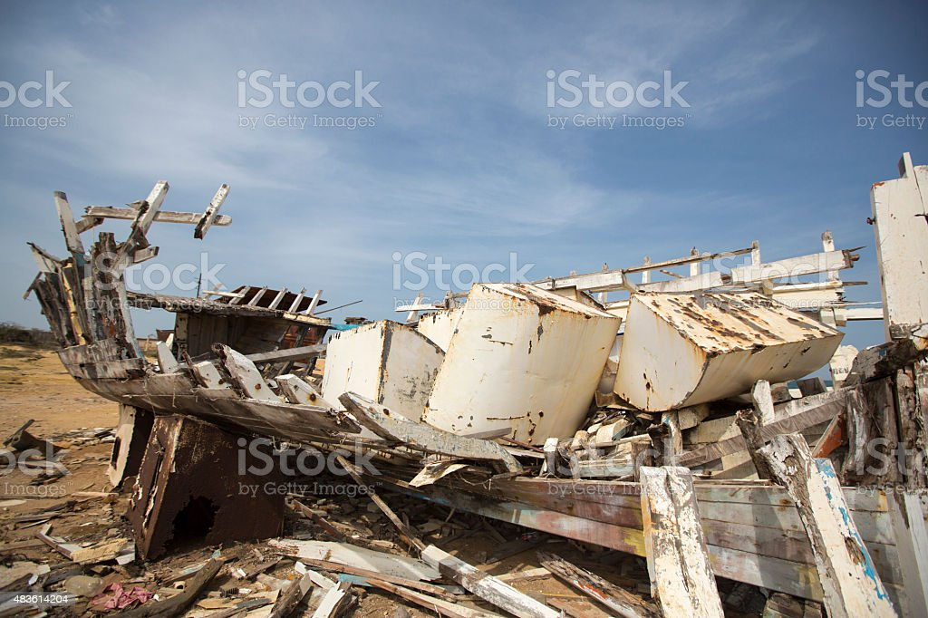 Old shipwreck disembowelled on the beach, Venezuela stock photo