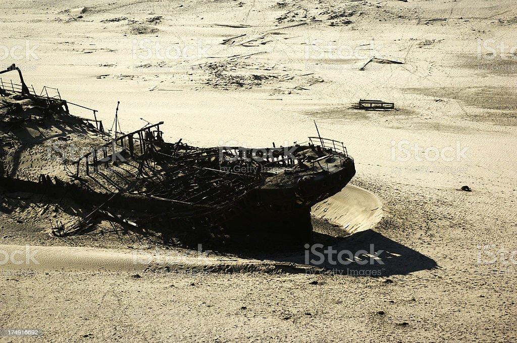 Old shipwreck in the Namib Desert stock photo
