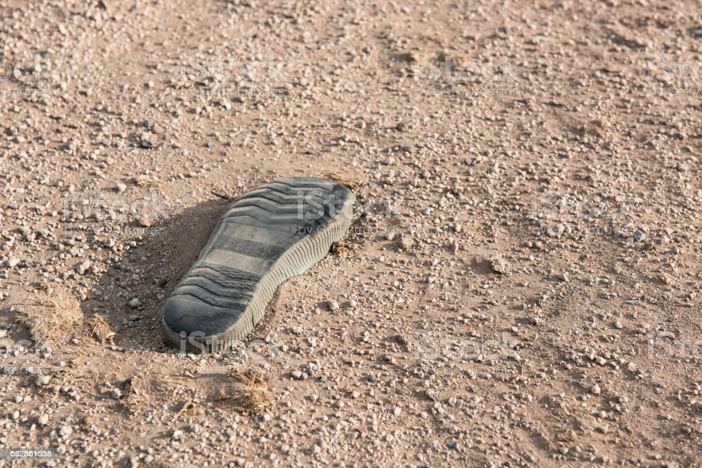 Old Shoe sole on the ground. stock photo