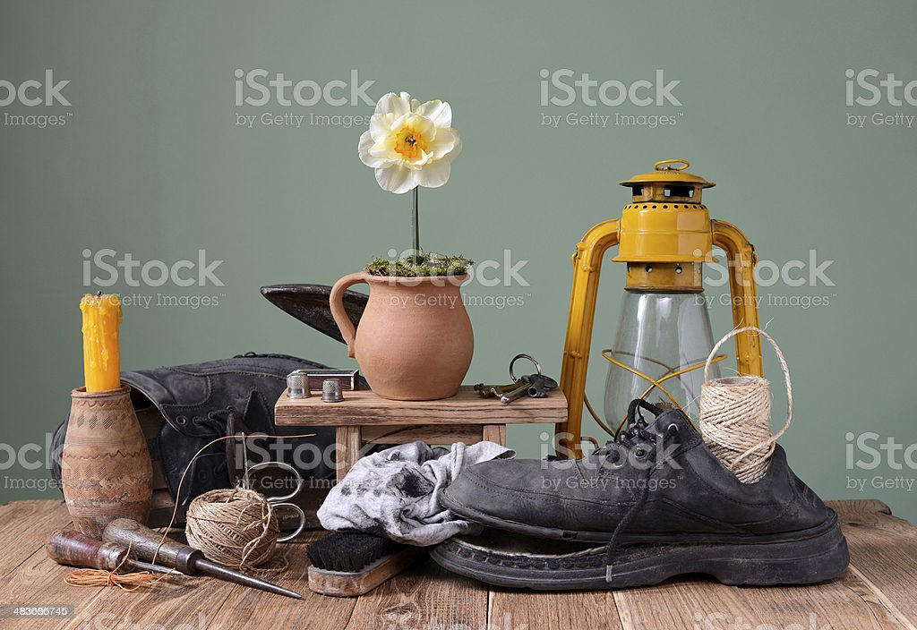 Old shoes and shoemaker tools stock photo