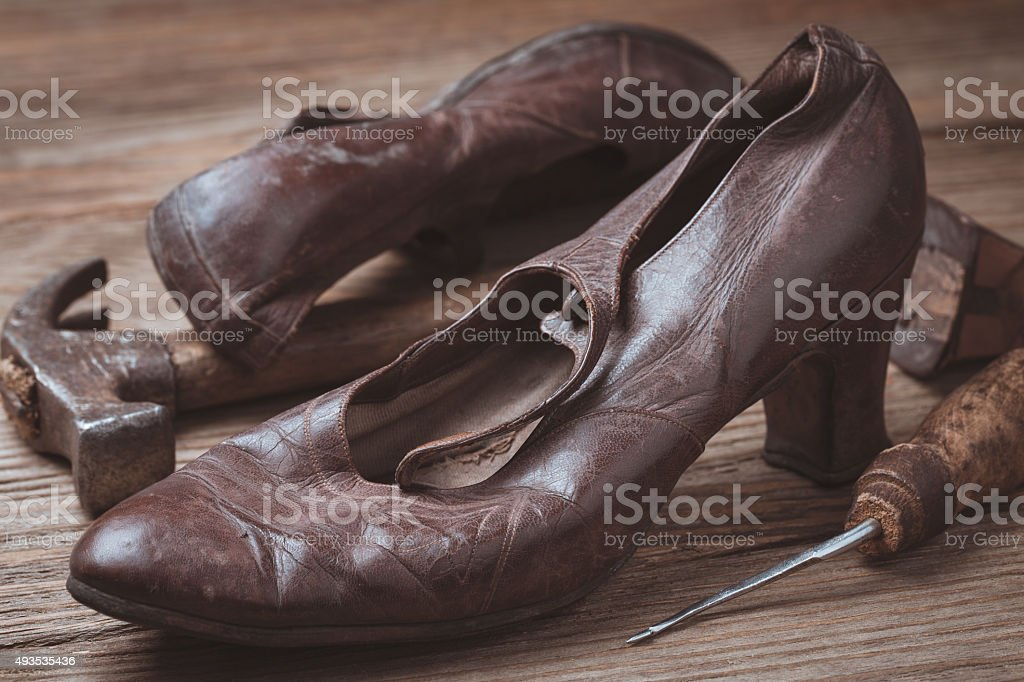 Old shoes and tools for recovery, closeup stock photo