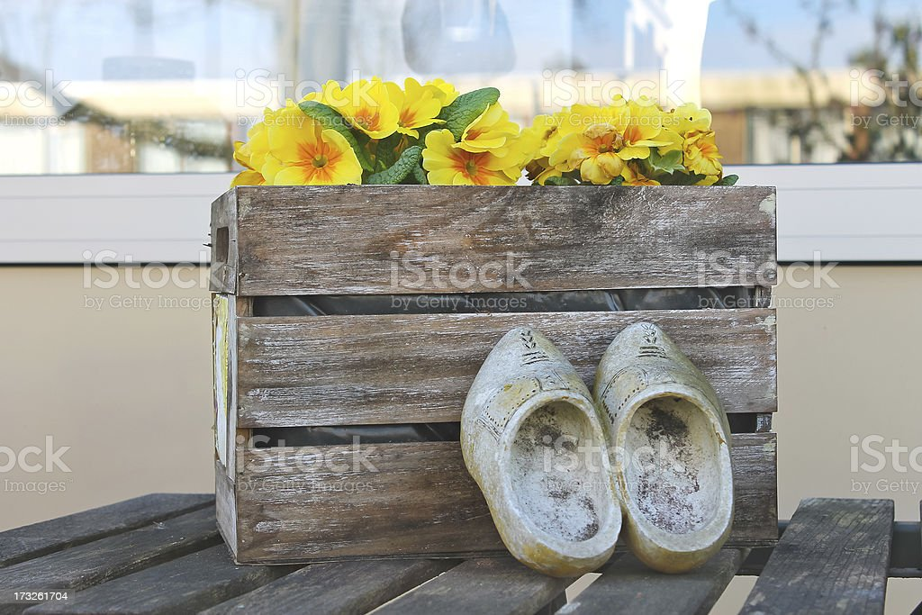 Old shoes near the box with flowers in Gorinchem. Netherlands royalty-free stock photo