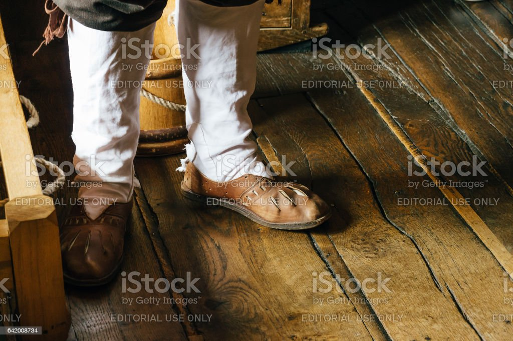Old shoes on a wooden tiled floor stock photo