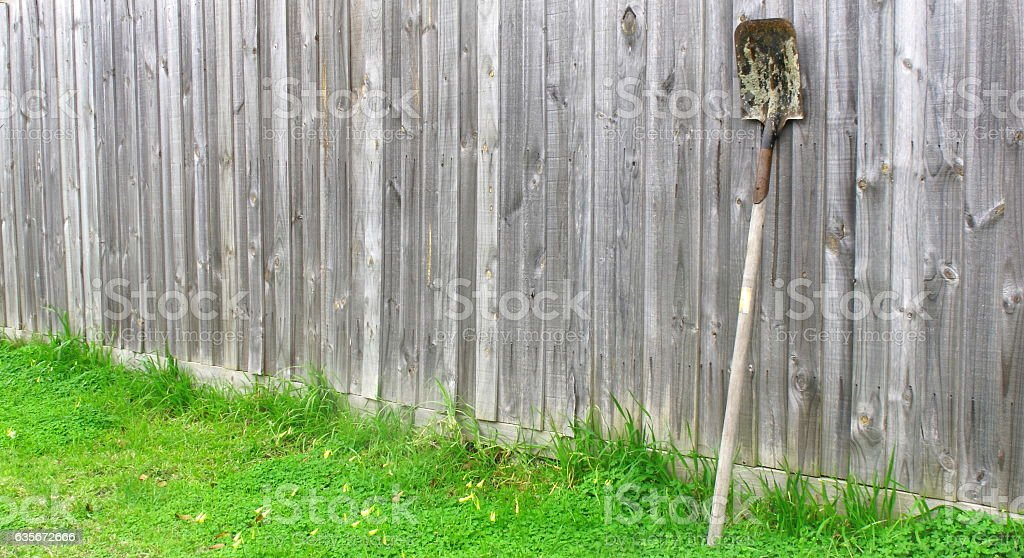 Old shovel leaning wood fence, Copy space stock photo