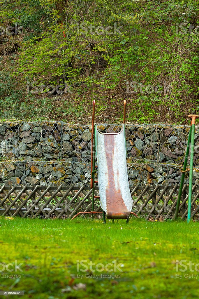 Old shute and slide in garden stock photo
