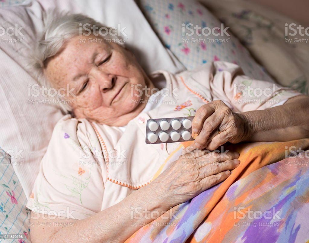 Old sick woman stock photo