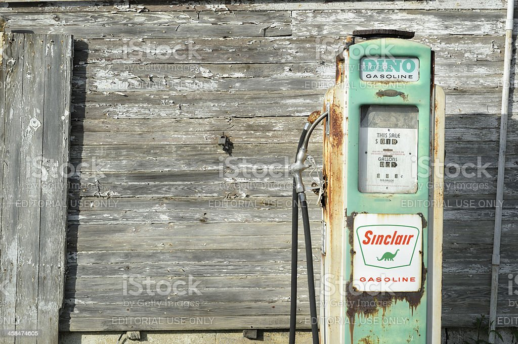Old Sinclair Gas Pump and Weathered Farm Building stock photo