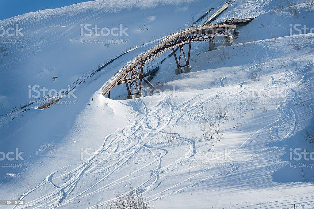 Old ski ramp in the snow stock photo