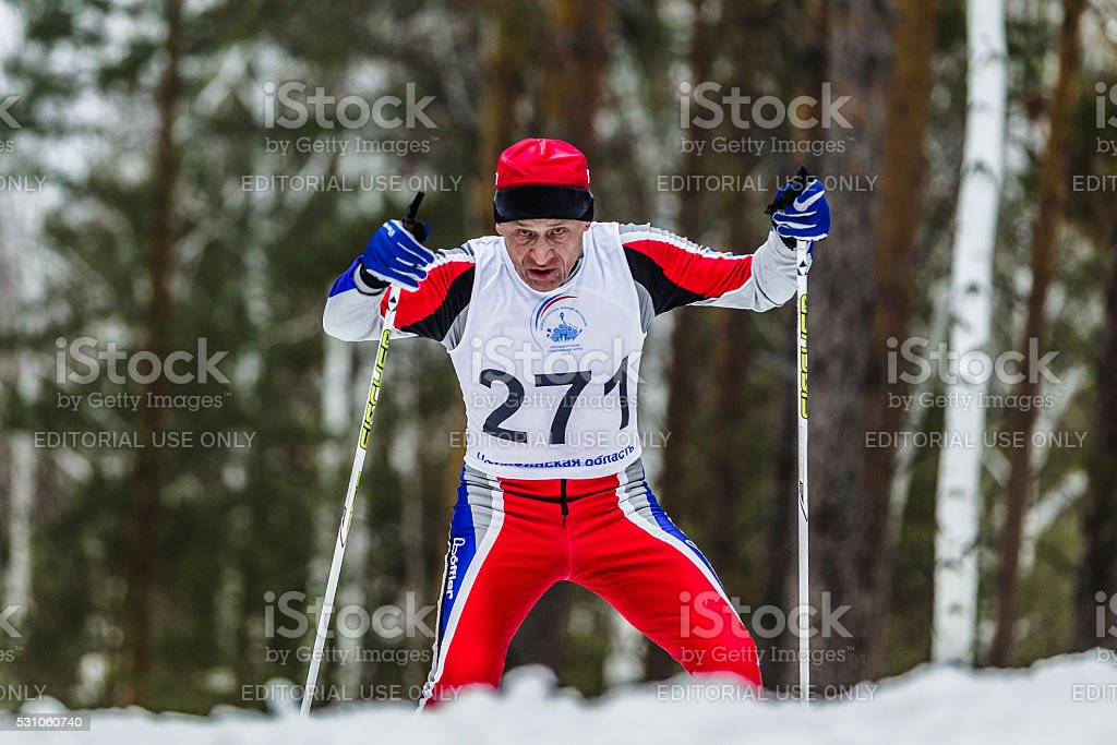 old skier athlete men running through woods stock photo