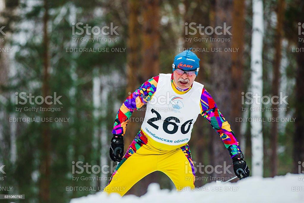old skier athlete men up mountain stock photo