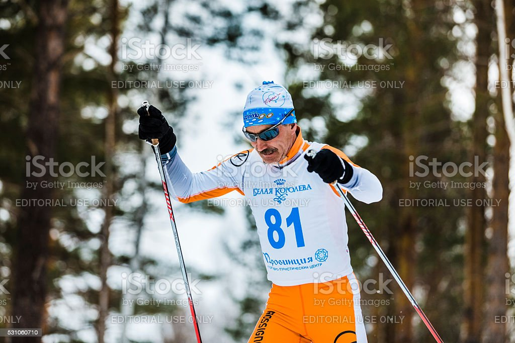 old skier men running through woods stock photo