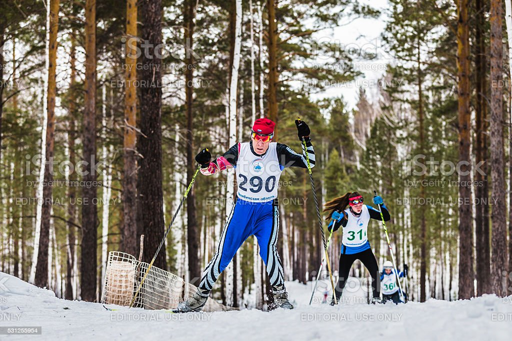 old skiers male athletes up mountain stock photo