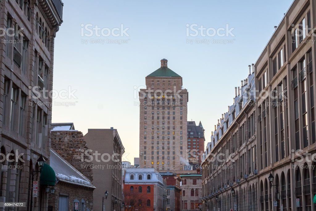 Old Skysraper seen from a street of Old Montreal stock photo