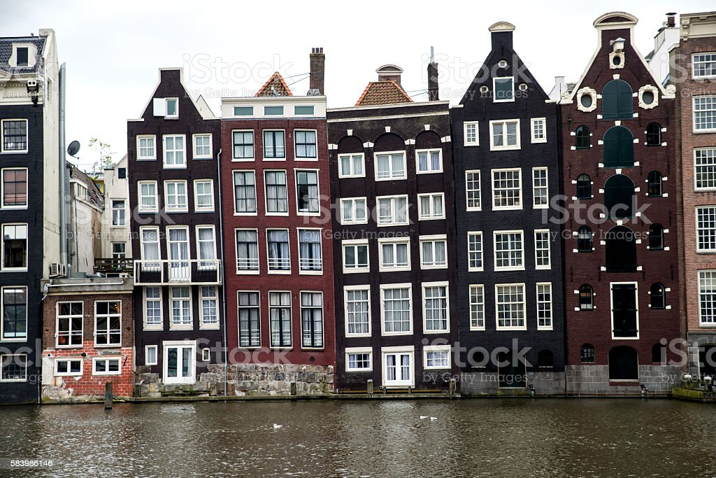 Old slanting canal buildings in Amsterdam stock photo