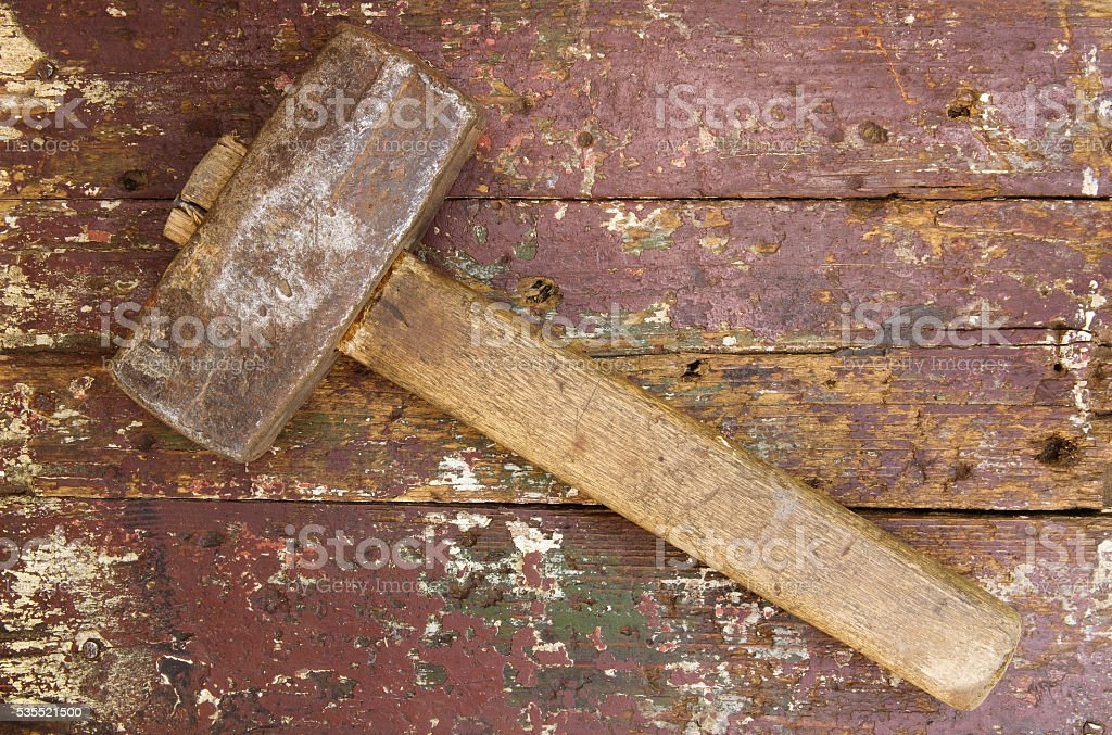 Old sledgehammer on the wooden background stock photo