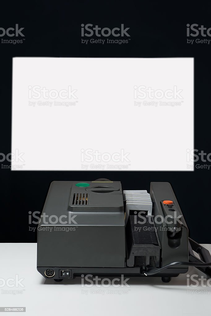 old slide projector that projects on the wall stock photo