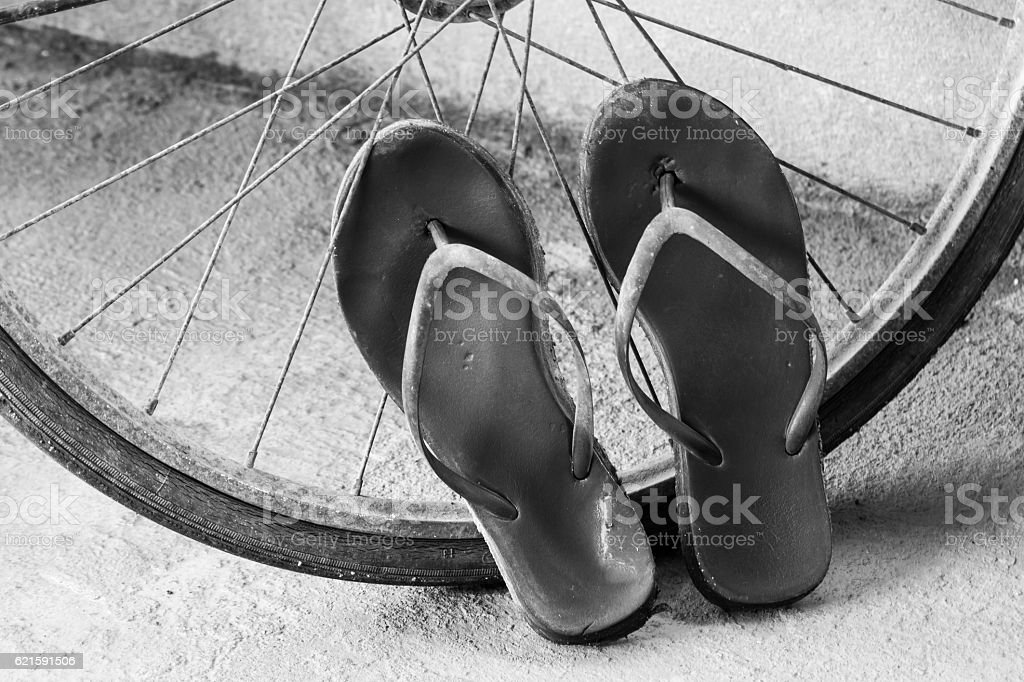 Old slippers and bicycle wheel stock photo